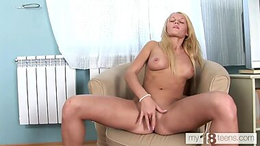 MY18TEENS - The bitch climbs into panties with her fingers and massages her pussy